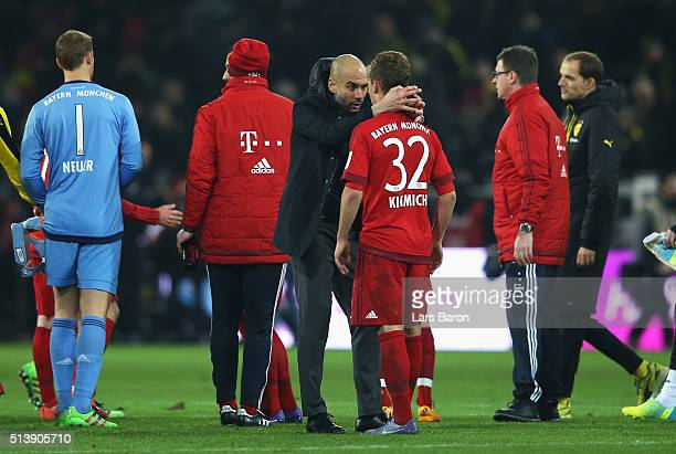 Josep Guardiola manager of Bayern Munich talks to Joshua Kimmich after the Bundesliga match between Borussia Dortmund and FC Bayern Muenchen at...