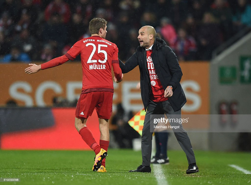 <a gi-track='captionPersonalityLinkClicked' href=/galleries/search?phrase=Josep+Guardiola&family=editorial&specificpeople=2088964 ng-click='$event.stopPropagation()'>Josep Guardiola</a> manager of Bayern Munich talks to <a gi-track='captionPersonalityLinkClicked' href=/galleries/search?phrase=Thomas+Mueller&family=editorial&specificpeople=5842906 ng-click='$event.stopPropagation()'>Thomas Mueller</a> of Bayern Munich during the Bundesliga match between FC Augsburg and FC Bayern Muenchen at SGL Arena on February 14, 2016 in Augsburg, Germany.