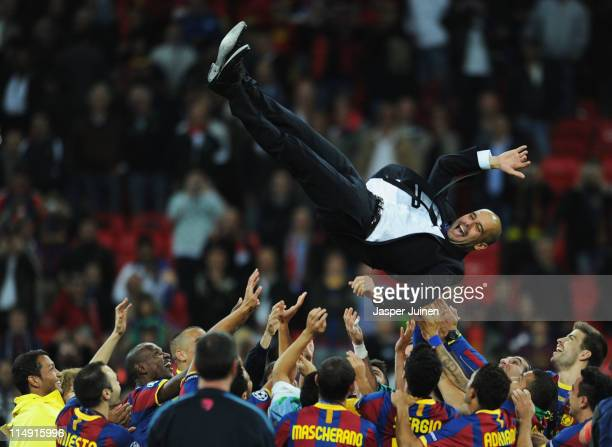 Josep Guardiola manager of FC Barcelona is thrown in the air as Barcelona celebrate victory in UEFA Champions League final between FC Barcelona and...