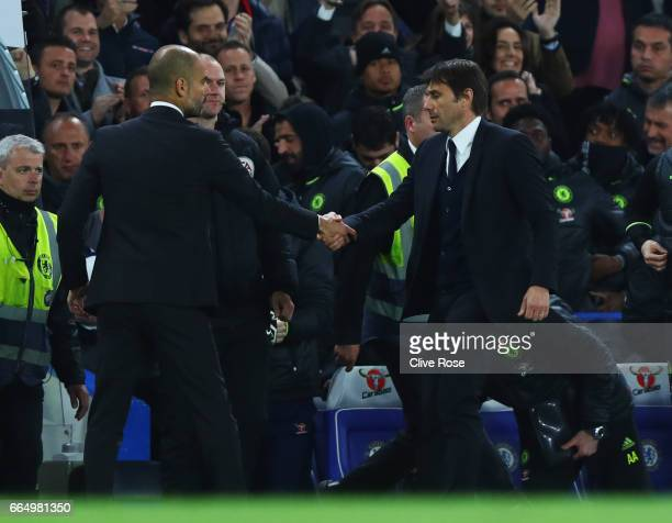 Josep Guardiola Manager of Manchester City and Antonio Conte Manager of Chelsea shake hands during the Premier League match between Chelsea and...