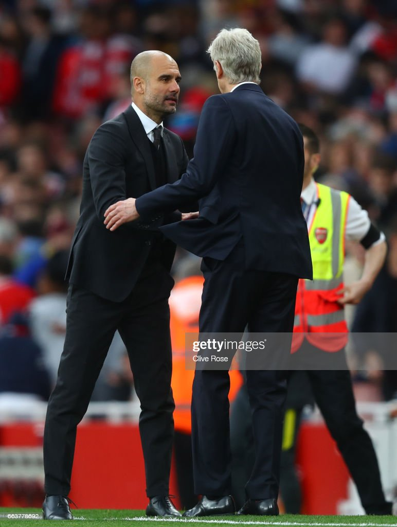 Josep Guardiola, Manager of Manchester City (L) and Arsene Wenger, Manager of Arsenal (R) shake hands after the Premier League match between Arsenal and Manchester City at Emirates Stadium on April 2, 2017 in London, England.