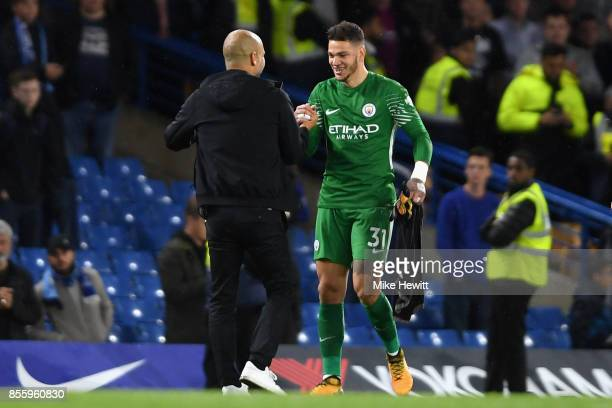 Josep Guardiola Manager of Manchester City and Ederson of Manchester City shake hands after the Premier League match between Chelsea and Manchester...