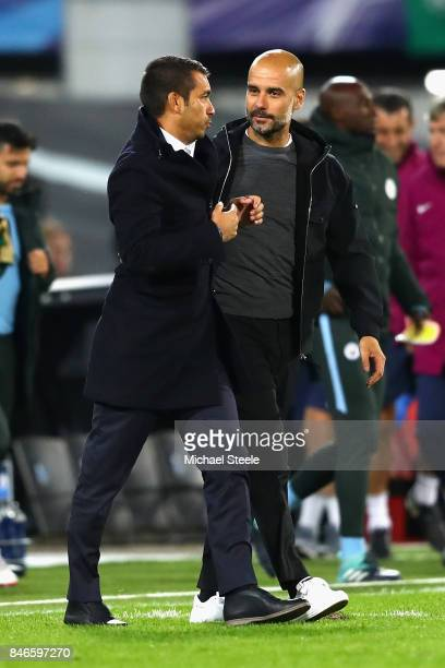 Josep Guardiola Manager of Manchester City and Giovanni Van Bronckhorst Manager of Feyenoord shake handa after the UEFA Champions League group F...
