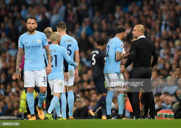 Josep Guardiola Manager of Manchester City and Kyle Walker of Manchester City dispute the sending off of Kyle Walker with the fourth official during...