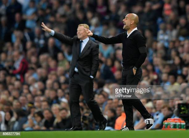 Josep Guardiola Manager of Manchester City and Ronald Koeman Manager of Everton give intruction during the Premier League match between Manchester...