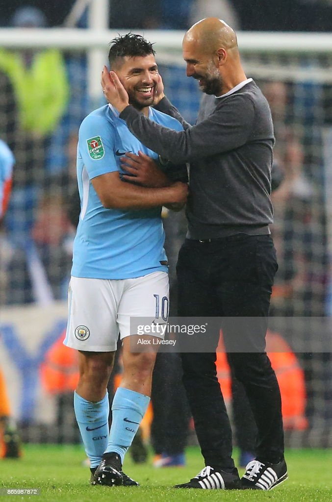 Josep Guardiola, Manager of Manchester City and Sergio Aguero of Manchester City celebrate after winning the penalty shoot out in the Carabao Cup Fourth Round match between Manchester City and Wolverhampton Wanderers at Etihad Stadium on October 24, 2017 in Manchester, England.