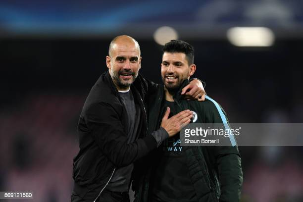 Josep Guardiola Manager of Manchester City and Sergio Aguero of Manchester City embrace after the UEFA Champions League group F match between SSC...