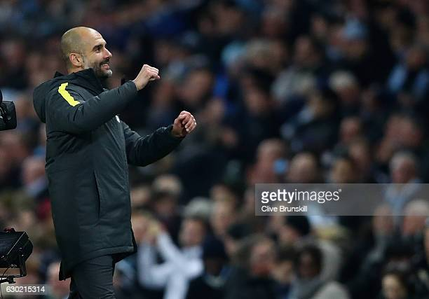 Josep Guardiola Manager of Manchester City celebrates after the final whistle during the Premier League match between Manchester City and Arsenal at...