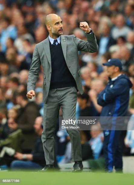 Josep Guardiola Manager of Manchester City celebrates his side scoring during the Premier League match between Manchester City and West Bromwich...