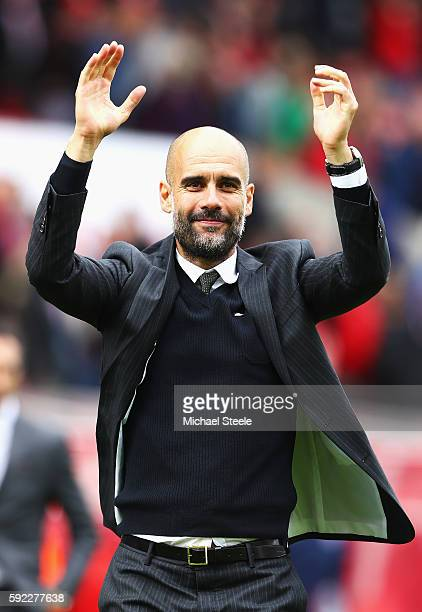 Josep Guardiola Manager of Manchester City celebrates his side win during the Premier League match between Stoke City and Manchester City at Bet365...