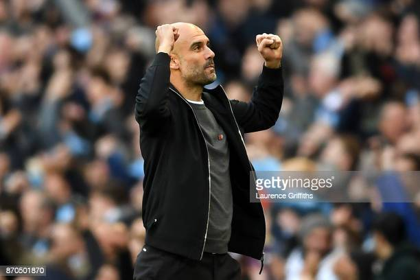 Josep Guardiola Manager of Manchester City celebrates his sides first goal during the Premier League match between Manchester City and Arsenal at...