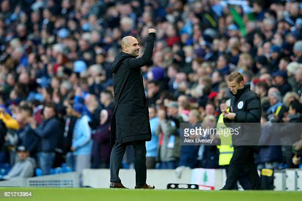 Josep Guardiola Manager of Manchester City celebrates his siide scoring during the Premier League match between Manchester City and Middlesbrough at...