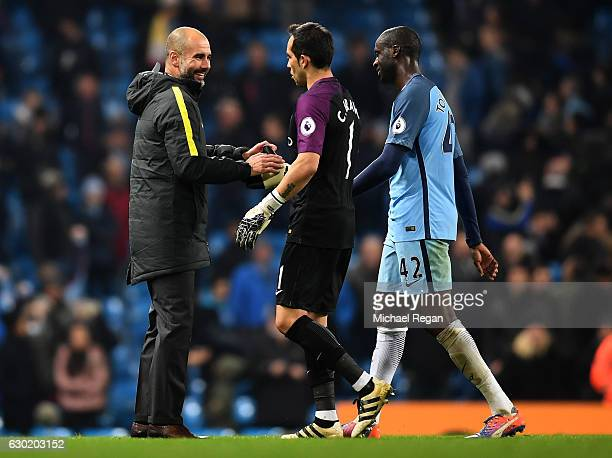 Josep Guardiola Manager of Manchester City celebrates with Claudio Bravo of Manchester City and Yaya Toure of Manchester City after the final whistle...