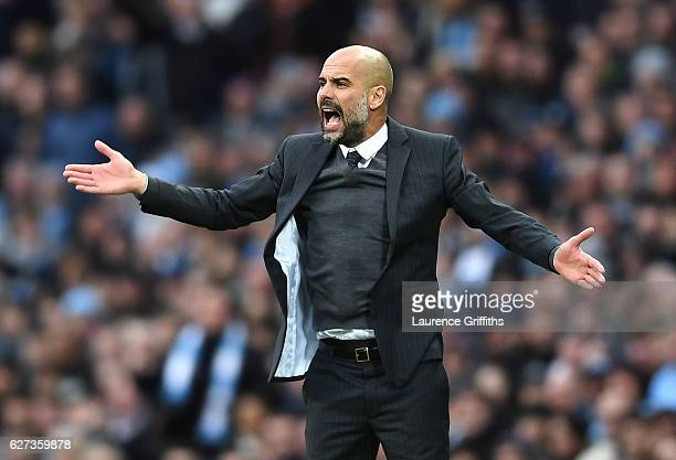 Josep Guardiola Manager of Manchester City gestures during the Premier League match between Manchester City and Chelsea at Etihad Stadium on December...
