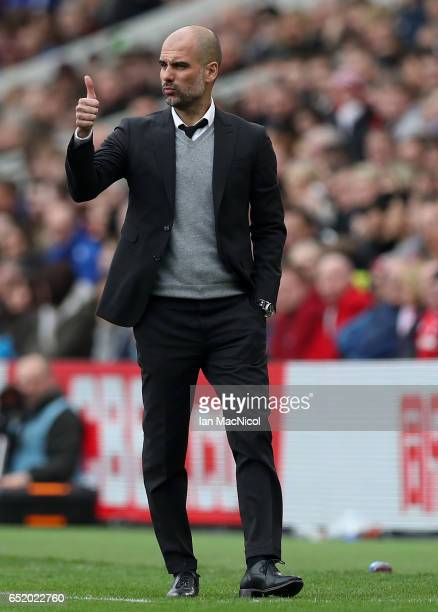 Josep Guardiola Manager of Manchester City gives his team a thumbs up during The Emirates FA Cup QuarterFinal match between Middlesbrough and...