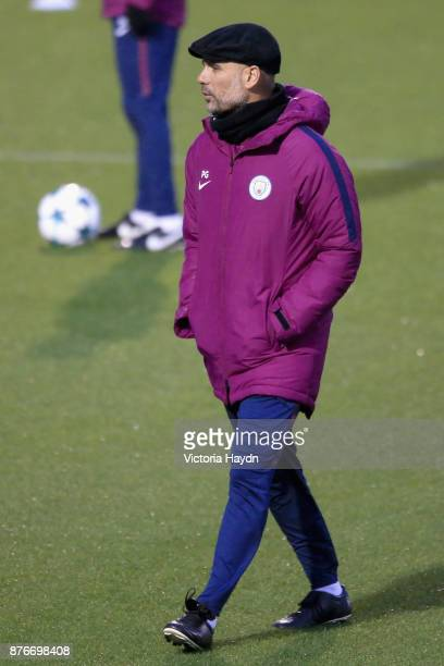 Josep Guardiola Manager of Manchester City gives his team instructions during Manchester City Training ahead of the Champions League group F match...