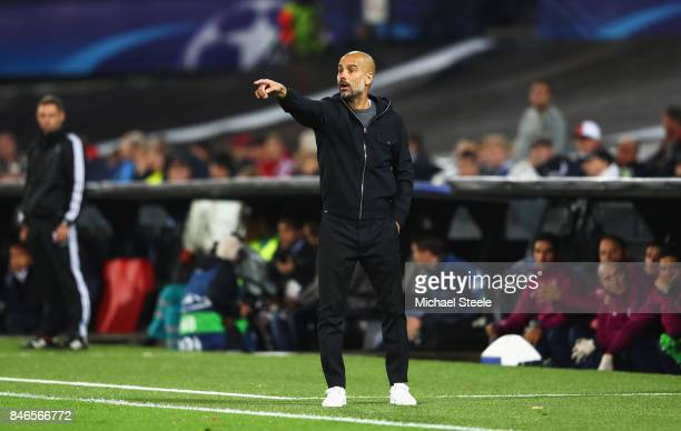 Josep Guardiola Manager of Manchester City gives his team instructions during the UEFA Champions League group F match between Feyenoord and...