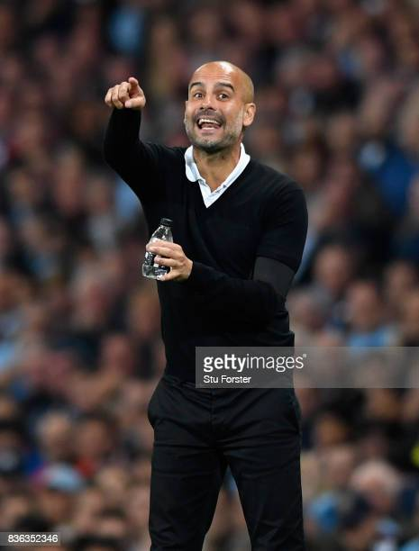 Josep Guardiola Manager of Manchester City gives instruction to his team during the Premier League match between Manchester City and Everton at...