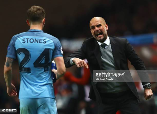 Josep Guardiola manager of Manchester City gives instructions to John Stones of Manchester City during the UEFA Champions League Round of 16 second...