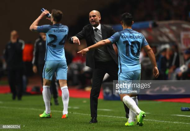 Josep Guardiola manager of Manchester City gives instructions to Sergio Aguero of Manchester City during the UEFA Champions League Round of 16 second...