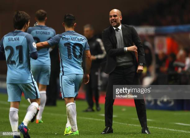 Josep Guardiola manager of Manchester City gives instructions to David Silva and Sergio Aguero of Manchester City during the UEFA Champions League...
