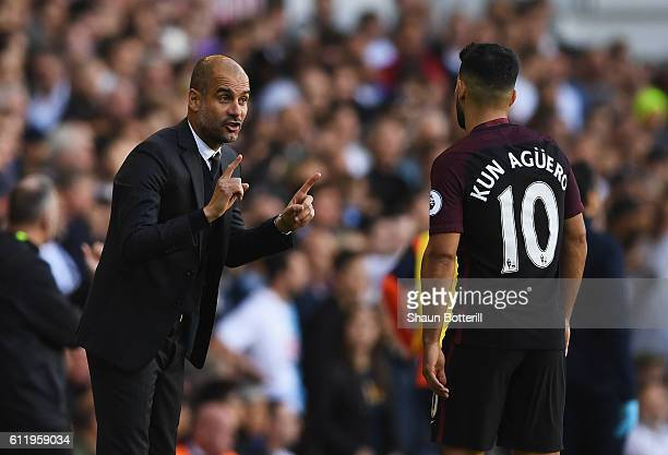 Josep Guardiola Manager of Manchester City gives Sergio Aguero of Manchester City instructions during the Premier League match between Tottenham...