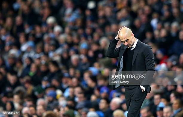 Josep Guardiola Manager of Manchester City look dejected on the sidelines during the Premier League match between Manchester City and Tottenham...
