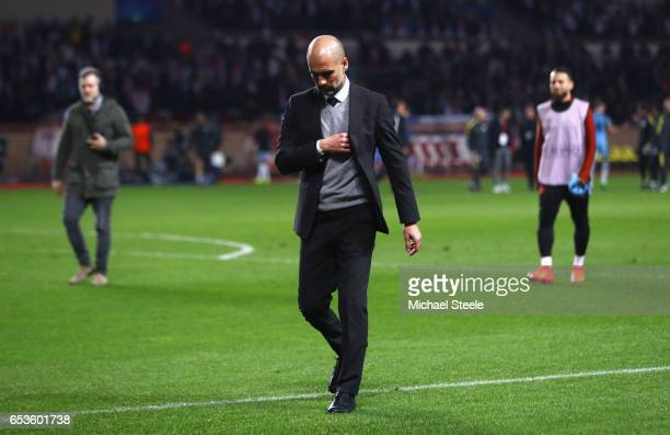 Josep Guardiola manager of Manchester City looks dejected in defeat after the UEFA Champions League Round of 16 second leg match between AS Monaco...