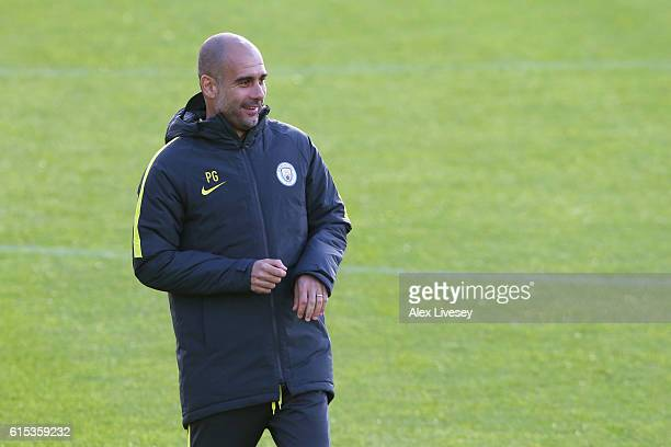Josep Guardiola Manager of Manchester City looks on during the Manchester City training session at the Football Academy Campus on October 18 2016 in...