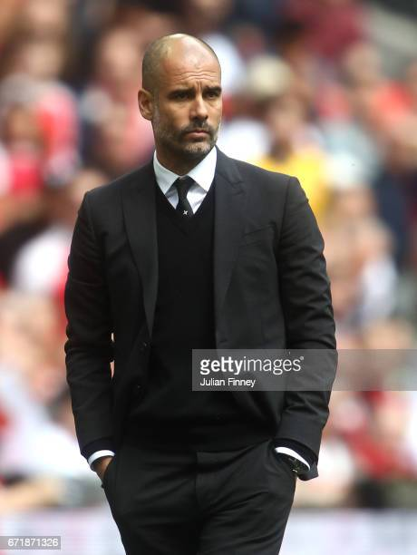 Josep Guardiola manager of Manchester City looks on during the Emirates FA Cup SemiFinal match between Arsenal and Manchester City at Wembley Stadium...