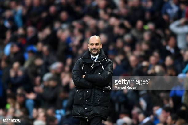 Josep Guardiola Manager of Manchester City looks on during the Premier League match between Manchester City and Liverpool at Etihad Stadium on March...