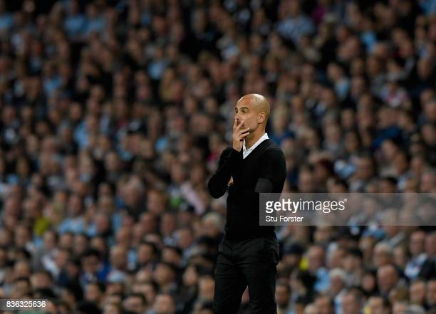 Josep Guardiola Manager of Manchester City looks on during the Premier League match between Manchester City and Everton at Etihad Stadium on August...