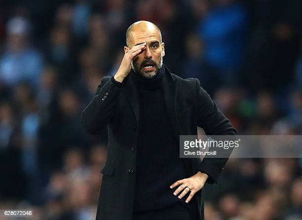 Josep Guardiola Manager of Manchester City looks on during the UEFA Champions League Group C match between Manchester City FC and Celtic FC at Etihad...