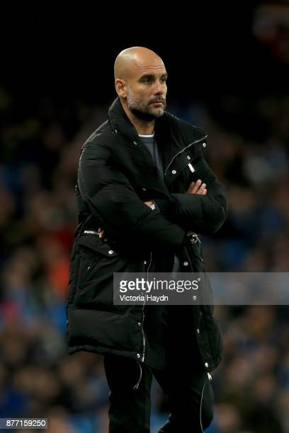Josep Guardiola Manager of Manchester City looks on during the UEFA Champions League group F match between Manchester City and Feyenoord at Etihad...