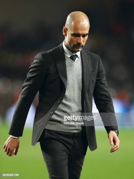Josep Guardiola manager of Manchester City looks thoughtful at half time during the UEFA Champions League Round of 16 second leg match between AS...