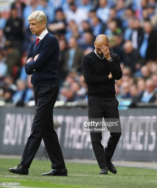 Josep Guardiola manager of Manchester City reacts after Arsenal's first goal during the Emirates FA Cup SemiFinal match between Arsenal and...