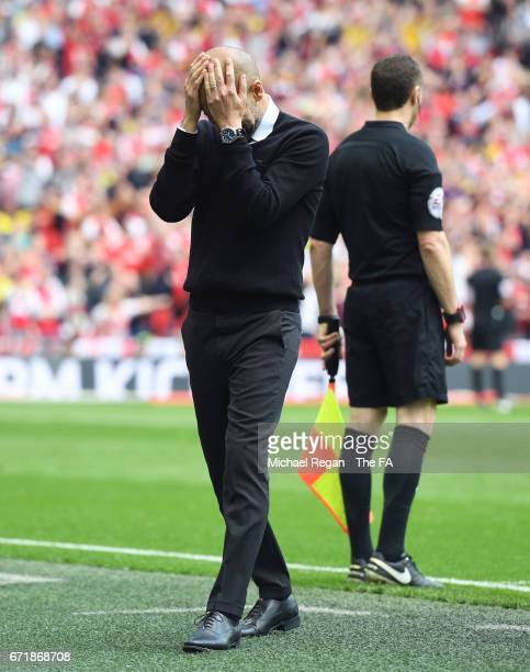 Josep Guardiola manager of Manchester City reacts after disallowed goal during the Emirates FA Cup SemiFinal match between Arsenal and Manchester...