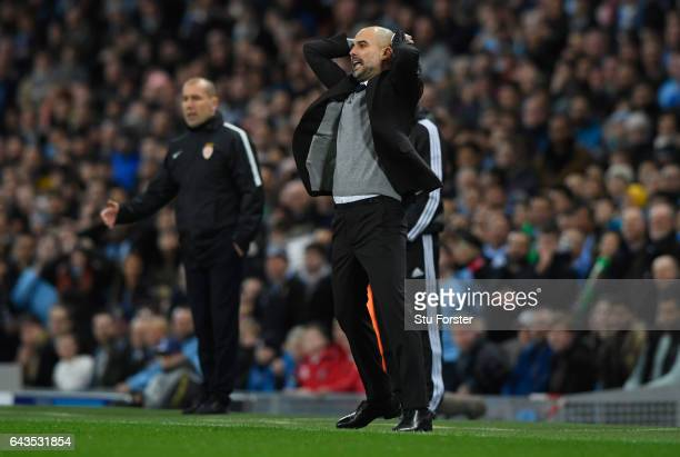 Josep Guardiola manager of Manchester City reacts as Leonardo Jardim head coach of AS Monaco looks on during the UEFA Champions League Round of 16...