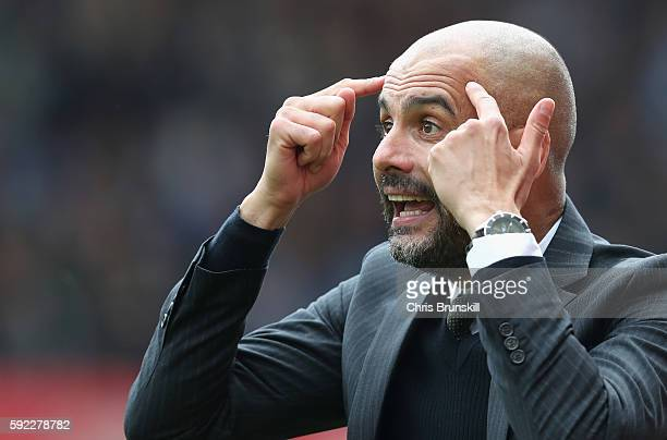 Josep Guardiola Manager of Manchester City reacts during the Premier League match between Stoke City and Manchester City at Bet365 Stadium on August...