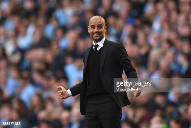 Josep Guardiola Manager of Manchester City reacts during the Premier League match between Manchester City and Hull City at Etihad Stadium on April 8...