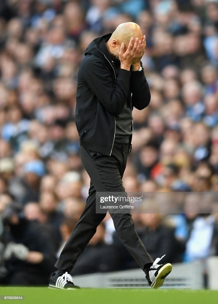 Josep Guardiola, Manager of Manchester City reacts during the Premier League match between Manchester City and Arsenal at Etihad Stadium on November 5, 2017 in Manchester, England.