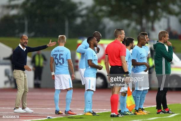Josep Guardiola Manager of Manchester City speaks to Alexander Zinchenko of Manchester City during a Pre Season Friendly between Manchester City and...