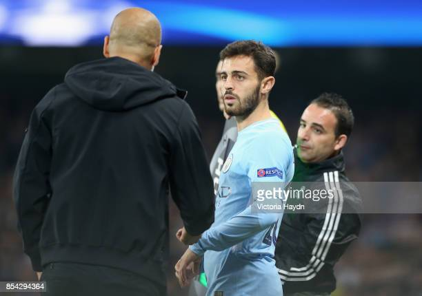 Josep Guardiola Manager of Manchester City speaks to Bernardo Silva of Manchester City before he comes on during the UEFA Champions League Group F...