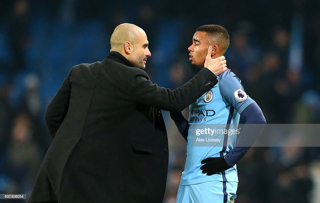 Josep Guardiola, Manager of Manchester City (L) speaks to Gabriel Jesus of Manchester City (R) on the pitch after the Premier League match between Manchester City and Tottenham Hotspur at the Etihad Stadium on January 21, 2017 in Manchester, England.