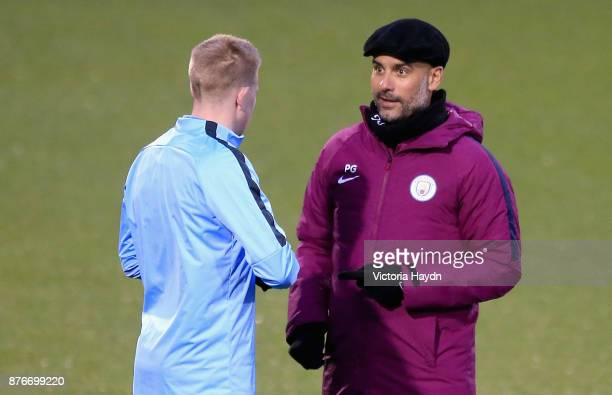 Josep Guardiola Manager of Manchester City speaks to Kevin De Bruyne of Manchester City during Manchester City Training ahead of the Champions League...