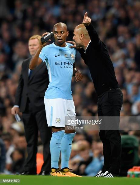 Josep Guardiola Manager of Manchester City speaks with Fernandinho of Manchester City during the Premier League match between Manchester City and...