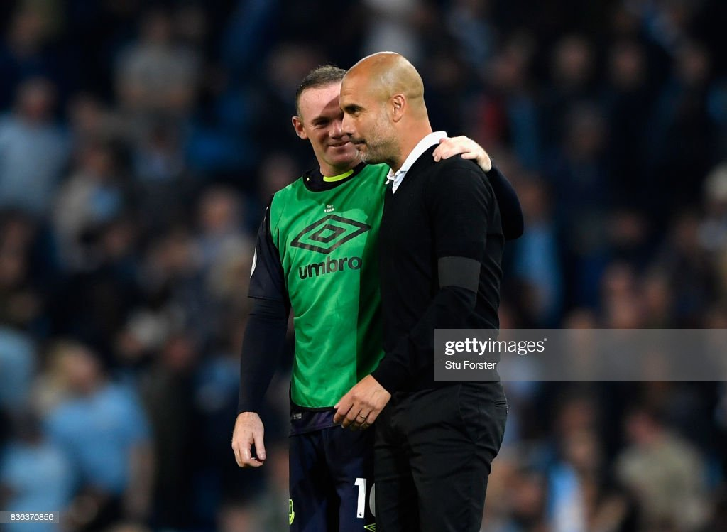 Josep Guardiola, Manager of Manchester City speaks with Wayne Rooney of Everton following the Premier League match between Manchester City and Everton at Etihad Stadium on August 21, 2017 in Manchester, England.