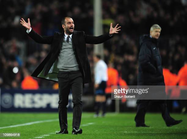 Josep Guardiola the Barcelona coach celebrates as Arsene Wenger the Arsenal coach looks on during the UEFA Champions League round of 16 second leg...