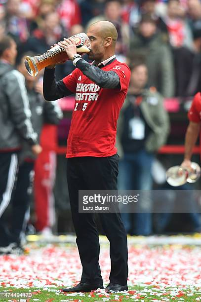 Josep Guardiola the head coach of Bayern Muenchen celebrates after winning the league during the Bundesliga match between FC Bayern Muenchen and 1...