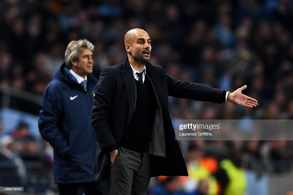 <a gi-track='captionPersonalityLinkClicked' href=/galleries/search?phrase=Josep+Guardiola&family=editorial&specificpeople=2088964 ng-click='$event.stopPropagation()'>Josep Guardiola</a> the head coach of Bayern Muenchen gestures as <a gi-track='captionPersonalityLinkClicked' href=/galleries/search?phrase=Manuel+Pellegrini&family=editorial&specificpeople=673553 ng-click='$event.stopPropagation()'>Manuel Pellegrini</a> the manager of Manchester City looks on during the UEFA Champions League Group E match between Manchester City and FC Bayern Muenchen at the Etihad Stadium on November 25, 2014 in Manchester, United Kingdom.